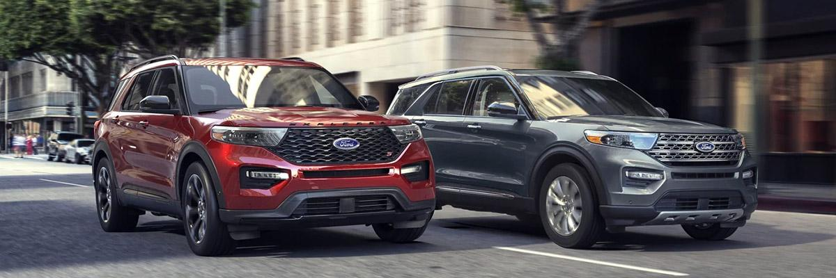 Ford SUVs driving down a city street