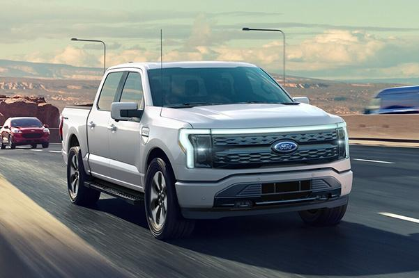 2022 FORD F-150 LIGHTNING driving on highway