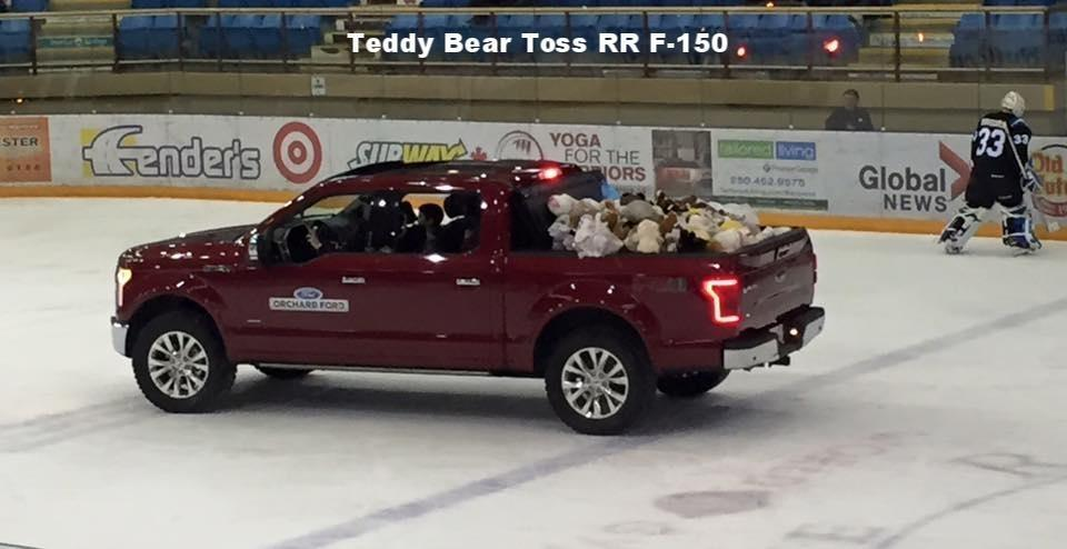 Red F-150 on hockey ice