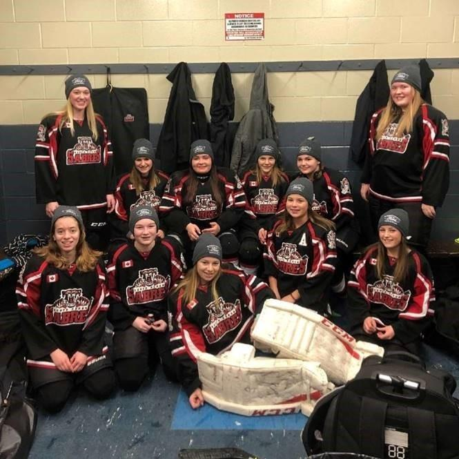 South Huron Bantam C Hockey Team Wearing our McDonnell Motors Toques