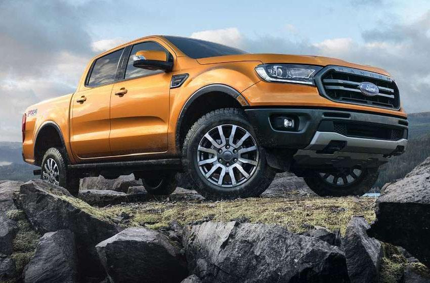 Saber orange Ford Ranger on a hill