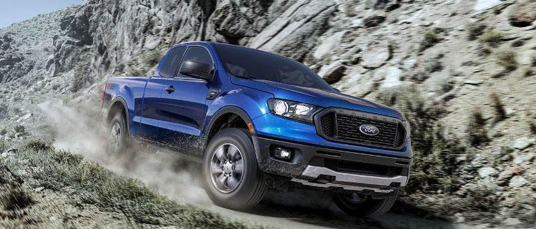 Lightning blue Ford Ranger Fx4 Off-Road Package driving along a mountain pass
