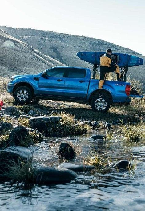 Lightning blue Ford Ranger driving over a river offroad