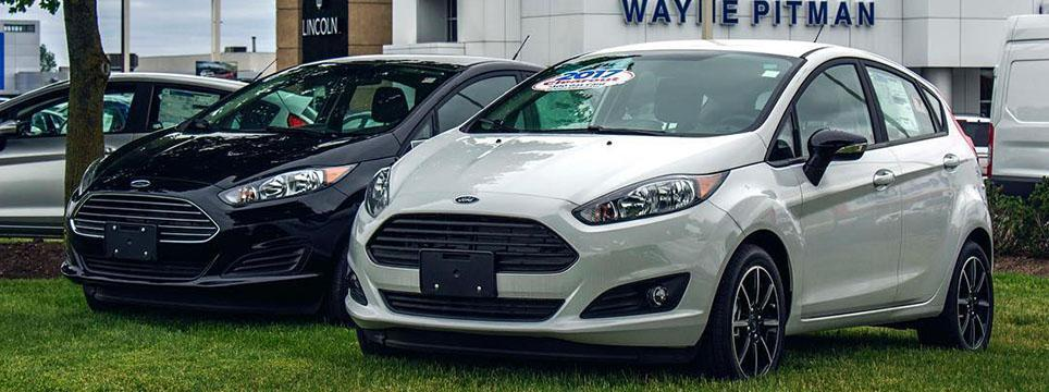 Used White 2017 Ford Fiesta in front of Wayne Pitman Ford in Guelph Ontario