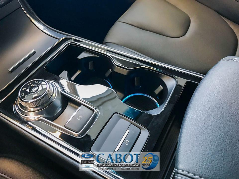 2019 Ford Edge Front Console with Rotary Gear Shift, Cup Holders with Stylish Blue Detail at Cabot Ford Lincoln in St. John's, Newfoundland and Labrador