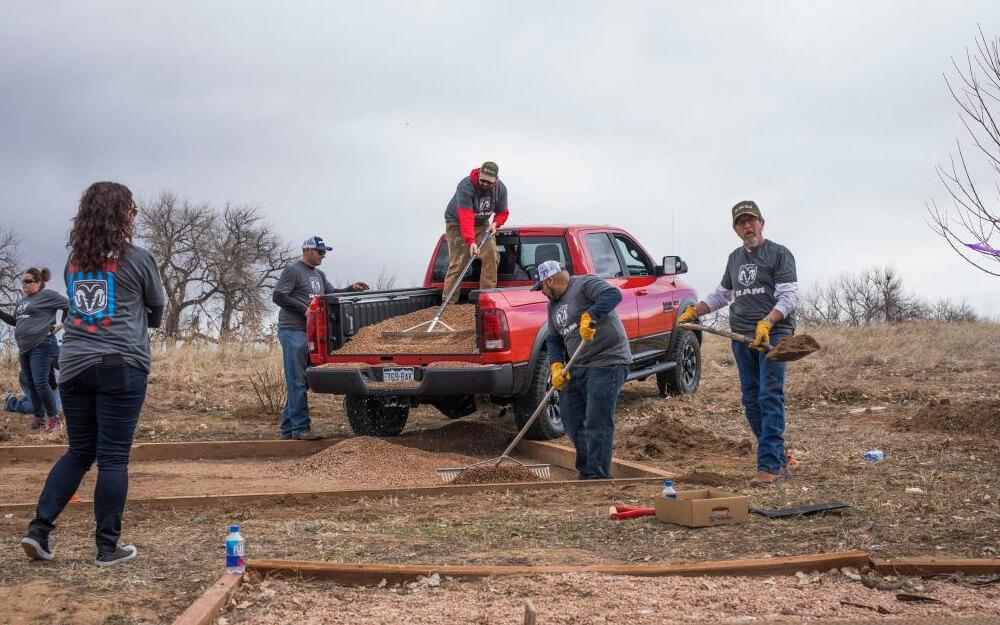 Ram Nation workers with red Ram truck