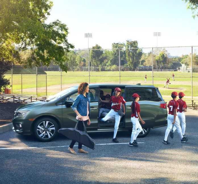 Baseball players exiting a Honda Odyssey