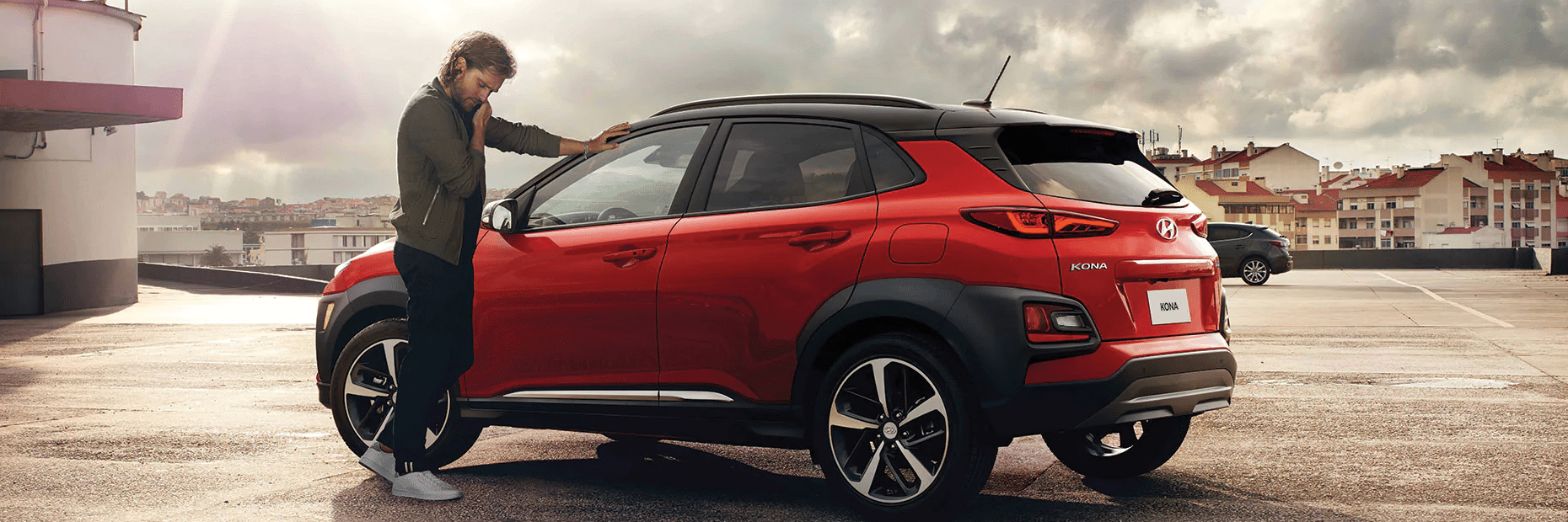 New Red Hyundai Kona with man
