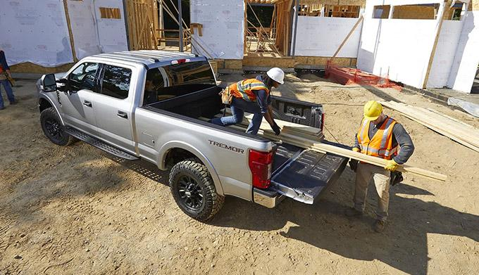 2021 Ford Super Duty on site with lumber in bed