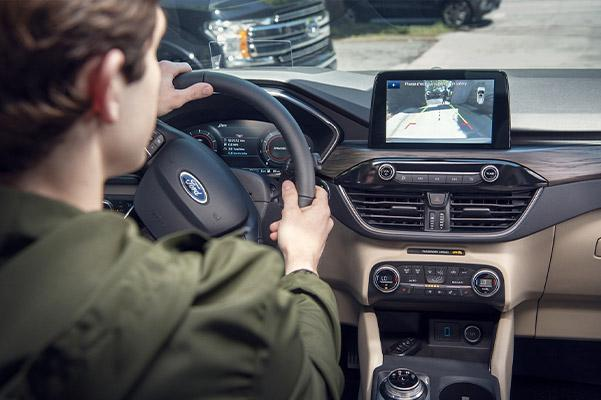 interio view of Ford Escape crossover showcasing rear view camera on the digital display