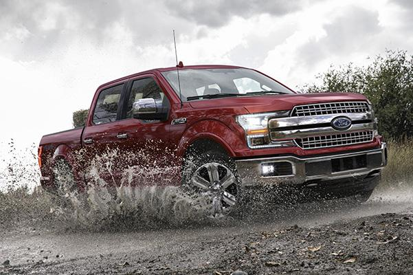 ref Ford F-150 pick up truck going through water and mud