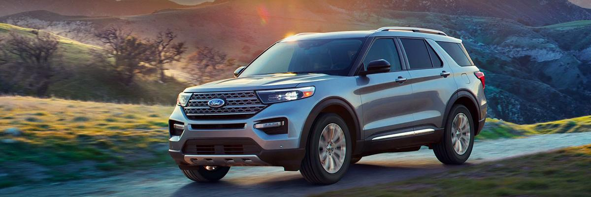A 2021 Ford Explorer Platinum in Iconic Silver being driven in the mountains