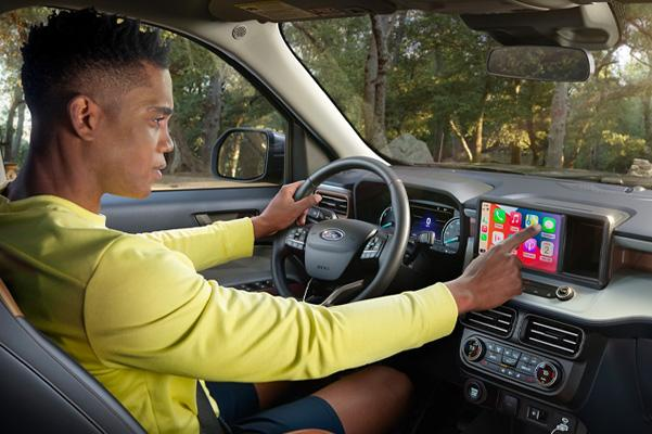 Man using dashboard touch screen in driver seat